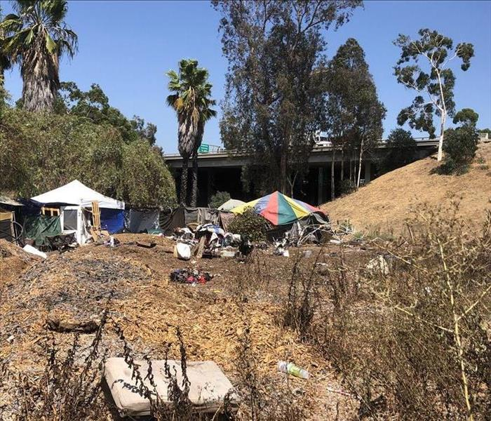 Homeless encampment near freeway.